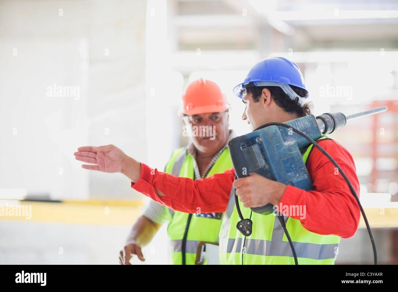 Workers with boring machine Stock Photo