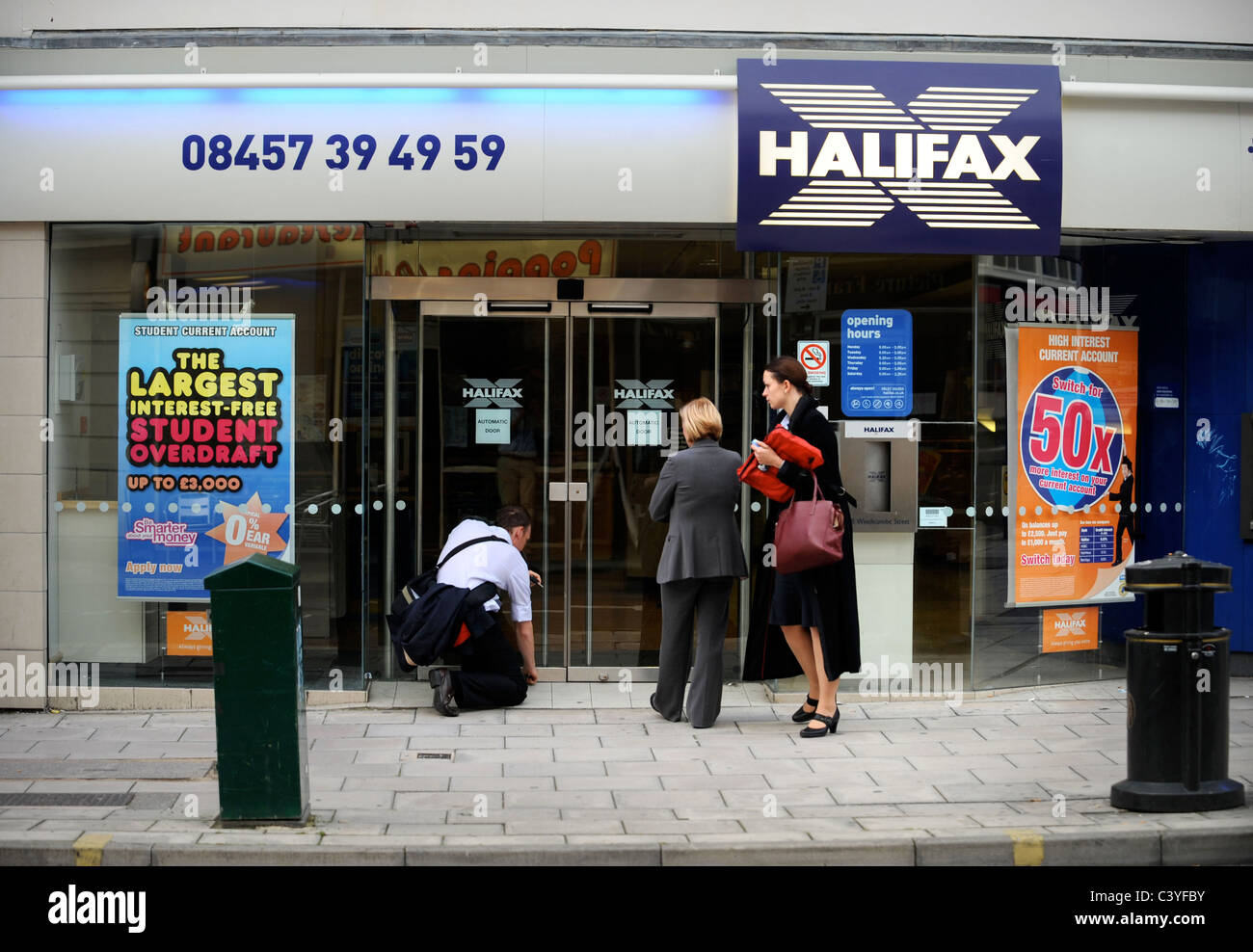 Staff lock up after work at The Cheltenham branch of The Halifax Bank Re. Merger of HBOS by Lloyds TSB in 2008 / - Stock Image