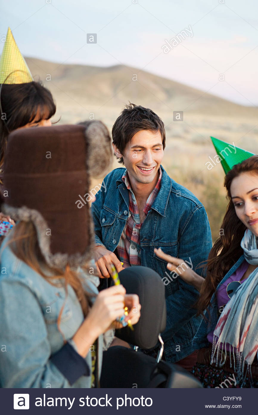 Four young people on road trip - Stock Image