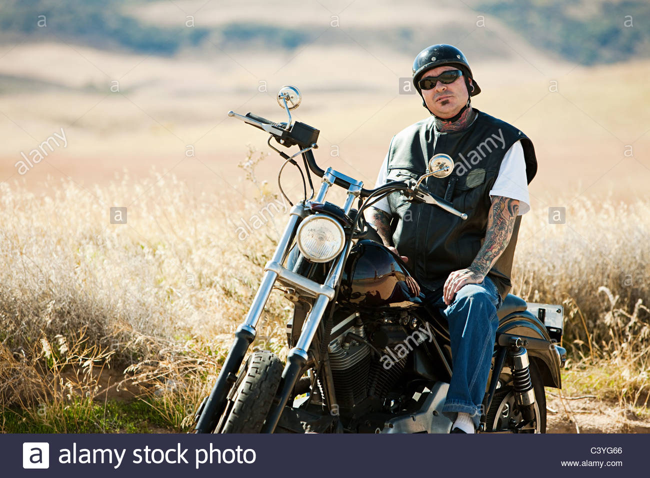 Portrait of man parked on motorcycle - Stock Image