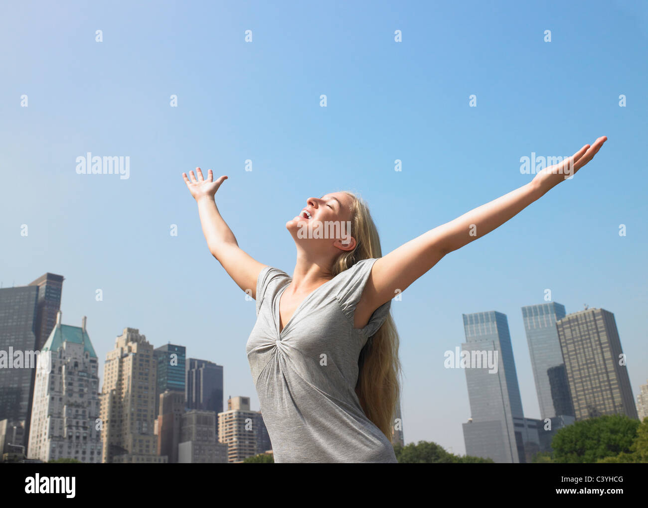 Woman enjoying the breeze on a hot day - Stock Image