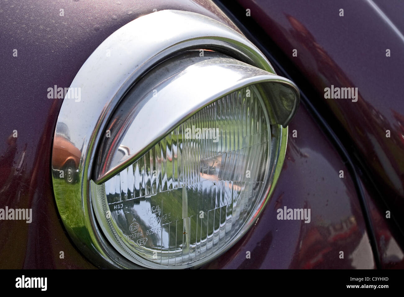 Headlight mounting on a classic VW Beetle saloon car - Stock Image