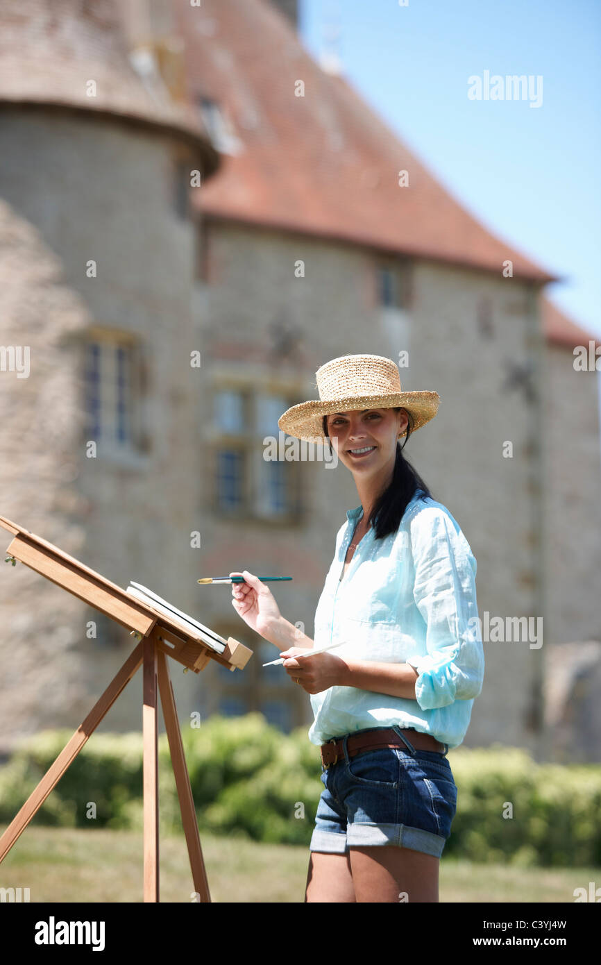 Woman painting a picture, outdoors Stock Photo