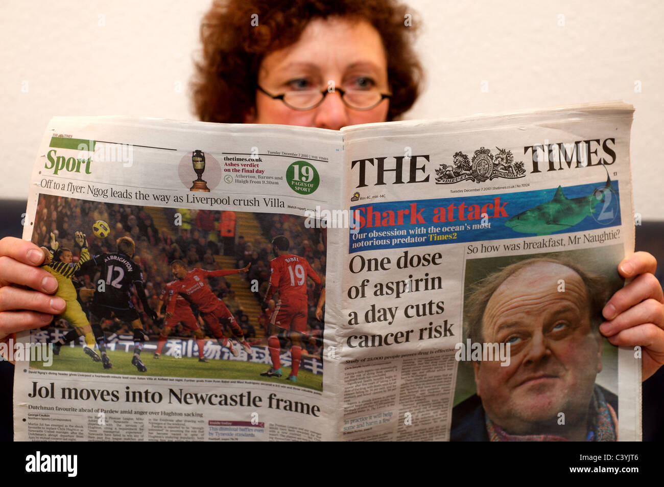 Woman reading The Times newspaper - Stock Image