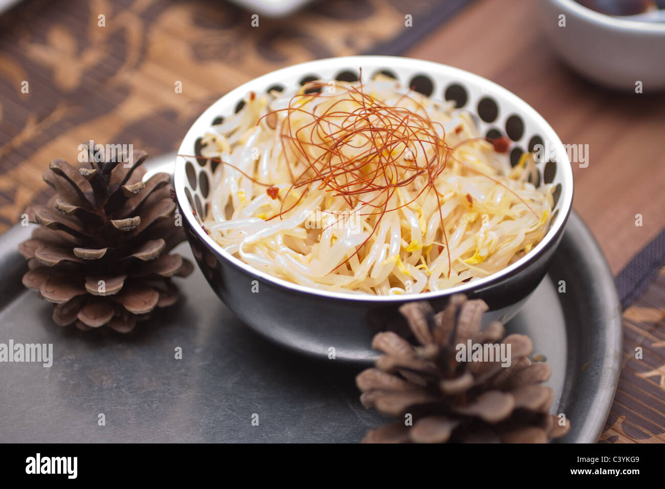 Bowl of mung bean seedling salad - Stock Image