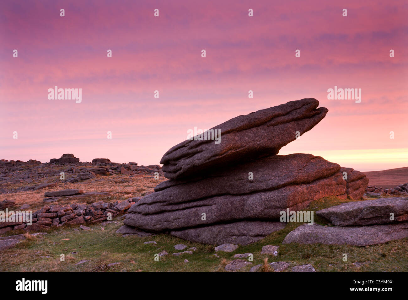 A Logan Rock at Higher Tor on Belstone Common at dawn, Dartmoor National Park, Devon, England. Winter (December) - Stock Image