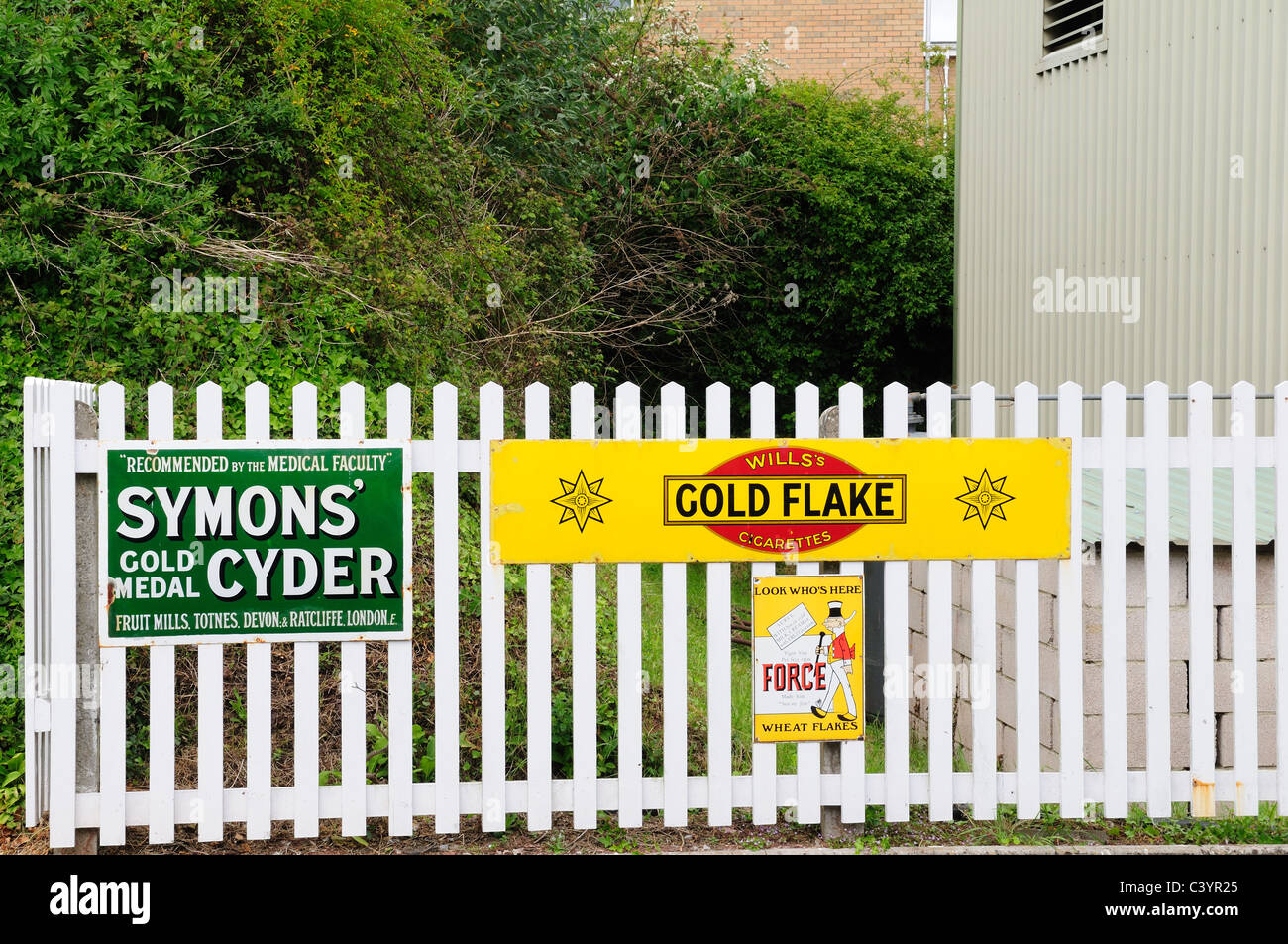 old Advertiziing signs on a Railway Station England - Stock Image