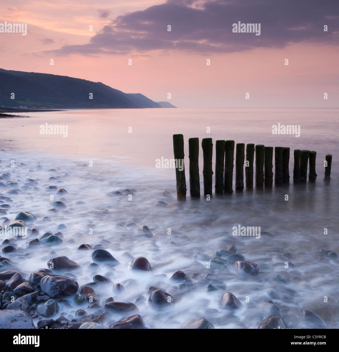 Wooden groynes on Bossington Beach at sunset, Exmoor National Park, Somerset, England. Spring (March) 2011. - Stock Image
