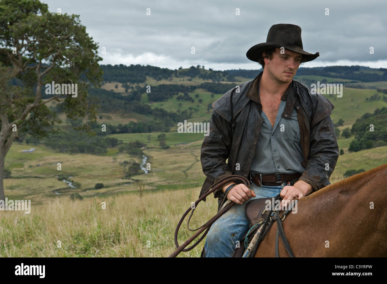 Man on horse in countrside Stock Photo