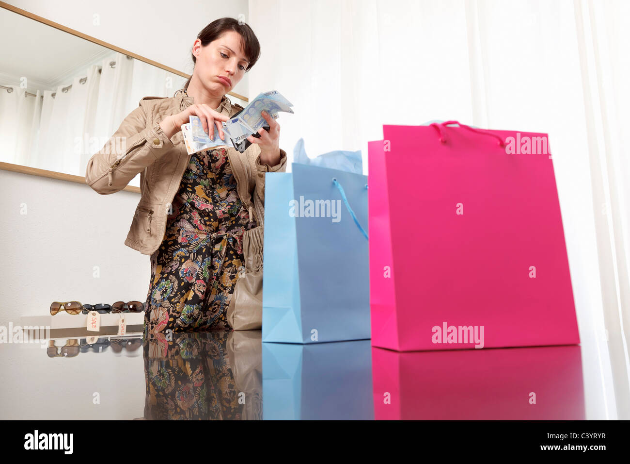 woman checking money from purse - Stock Image