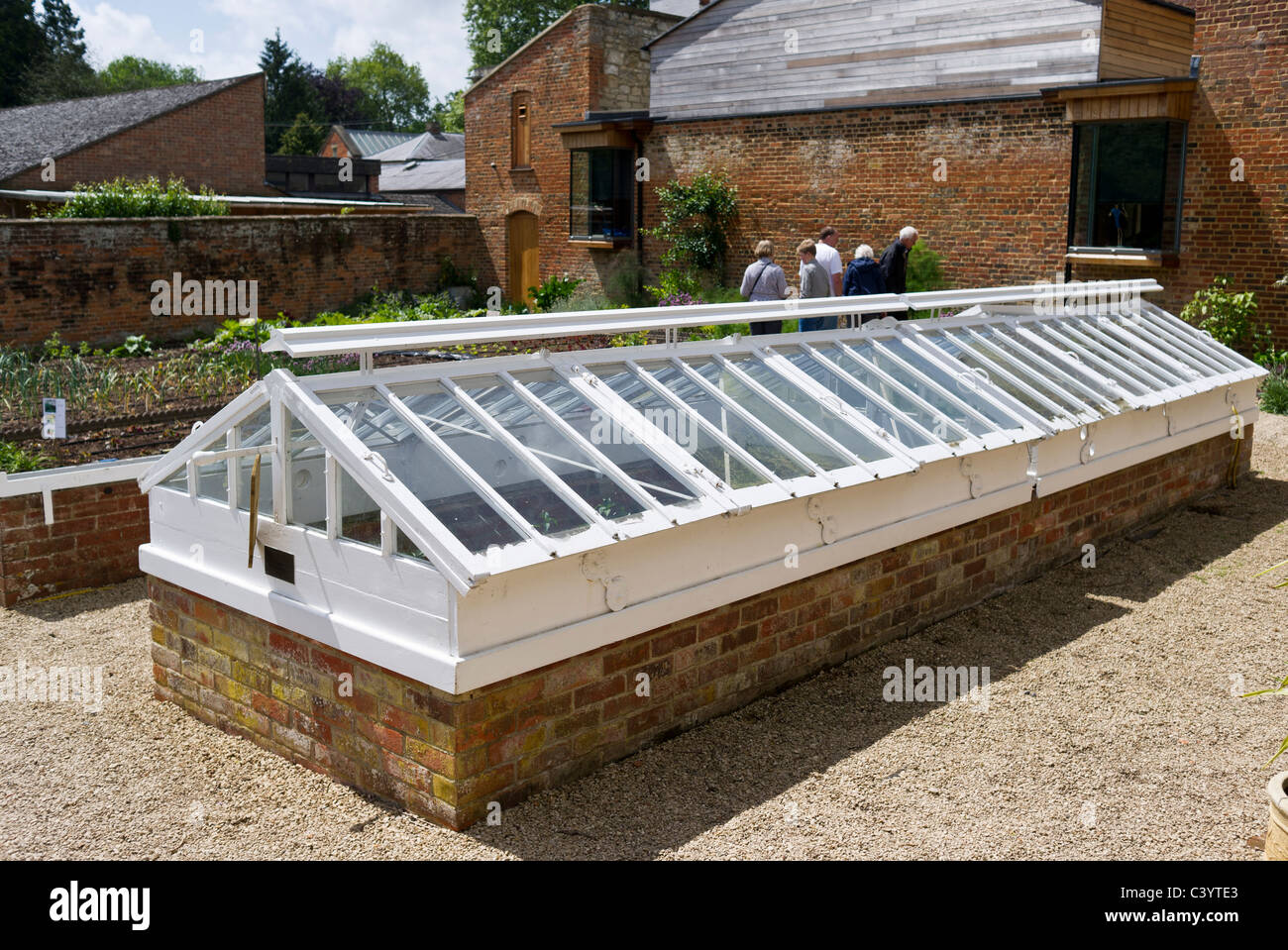 Double Dutch Lights with raised variable ridge ventilators in a walled garden - Stock Image