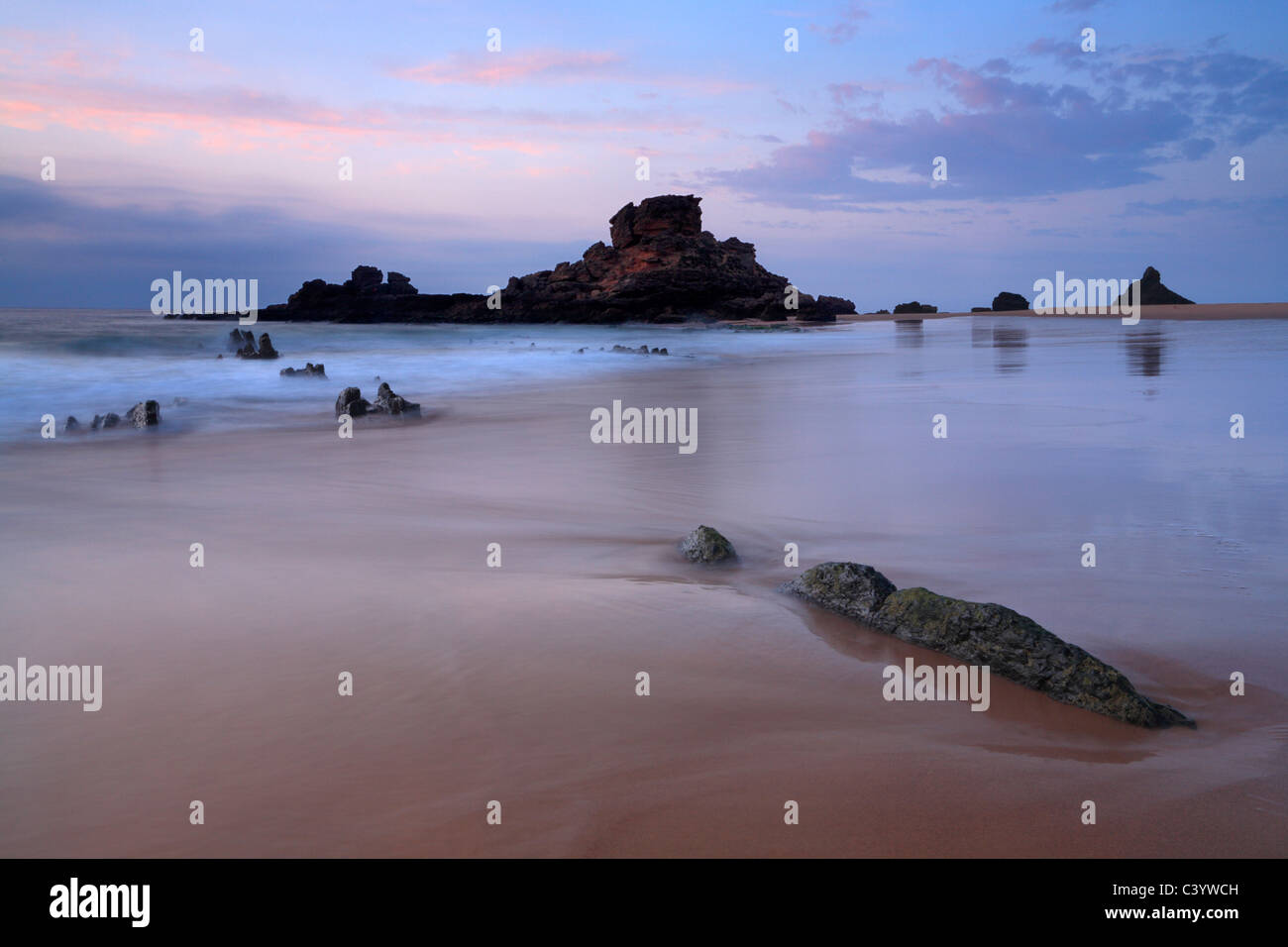 Sunset on the beautiful beach at Praia de Castelejo near Villa do Bispo in the Algarve region of Portugal - Stock Image