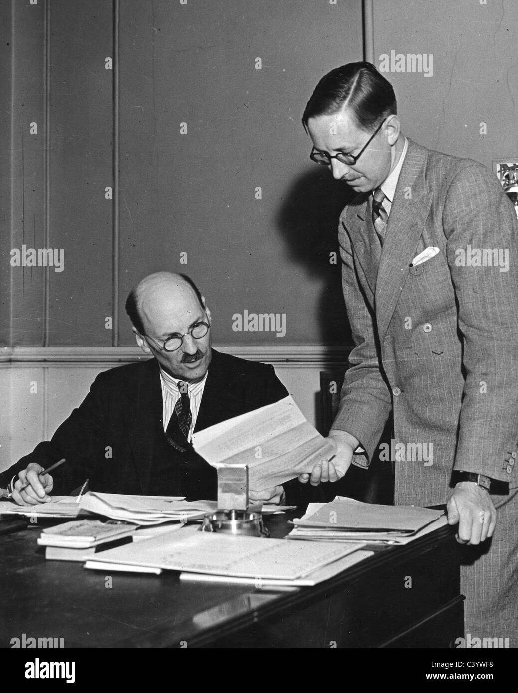 CLEMENT ATTLEE (1883-1967) as British Labour Prime Minister in 1946 with one of his Secretaries - Stock Image