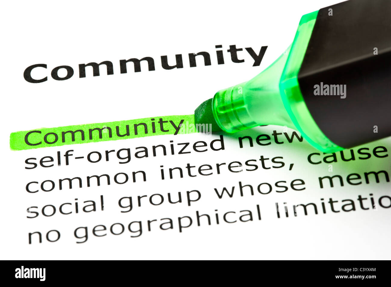 The word 'Community' highlighted in green with felt tip pen - Stock Image