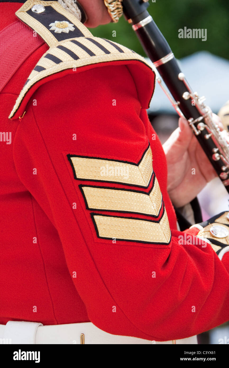 Close-up shoulder & arm of sergeant in the band of the Scots Guards in ceremonial uniform. - Stock Image