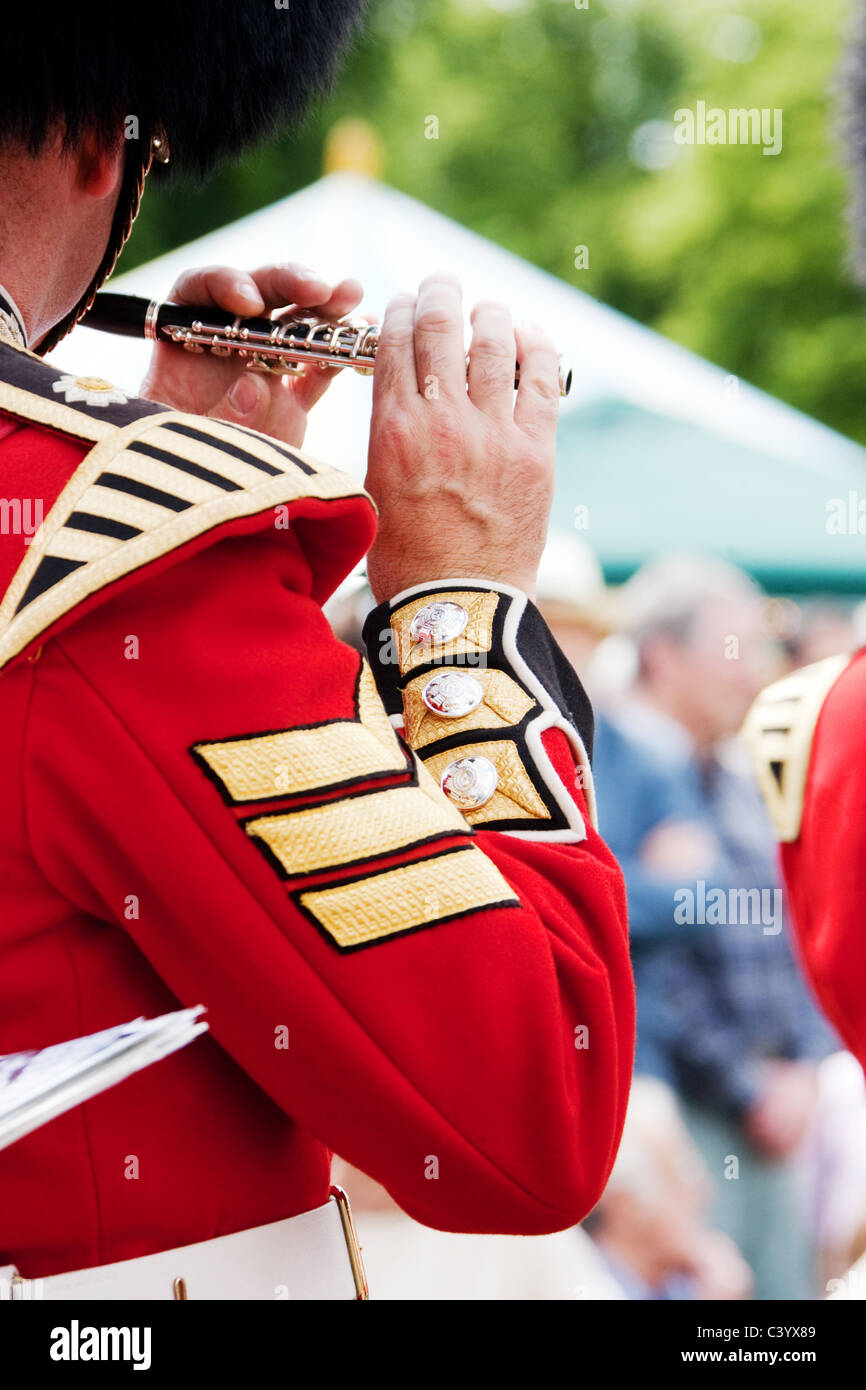 Close-up head, shoulder & arm of sergeant in the band of the Scots Guards in ceremonial uniform. - Stock Image