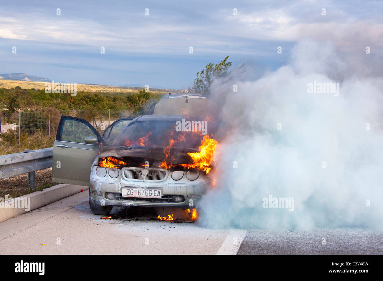 Croatia, Europe, accident, casualty, car, automobile, burn, smoke, street - Stock Image