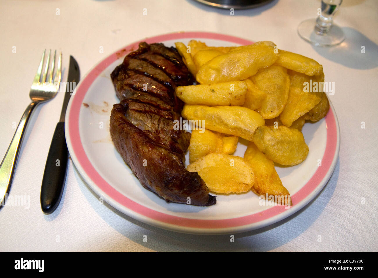 Meal of steak and fries in Buenos Aires, Argentina. - Stock Image
