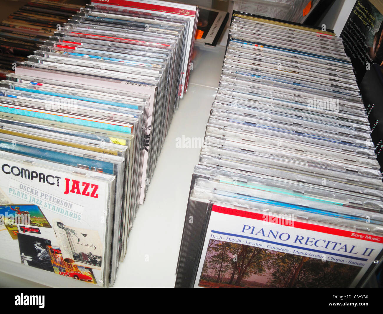 Music CD's for sale in secondhand shop Stock Photo