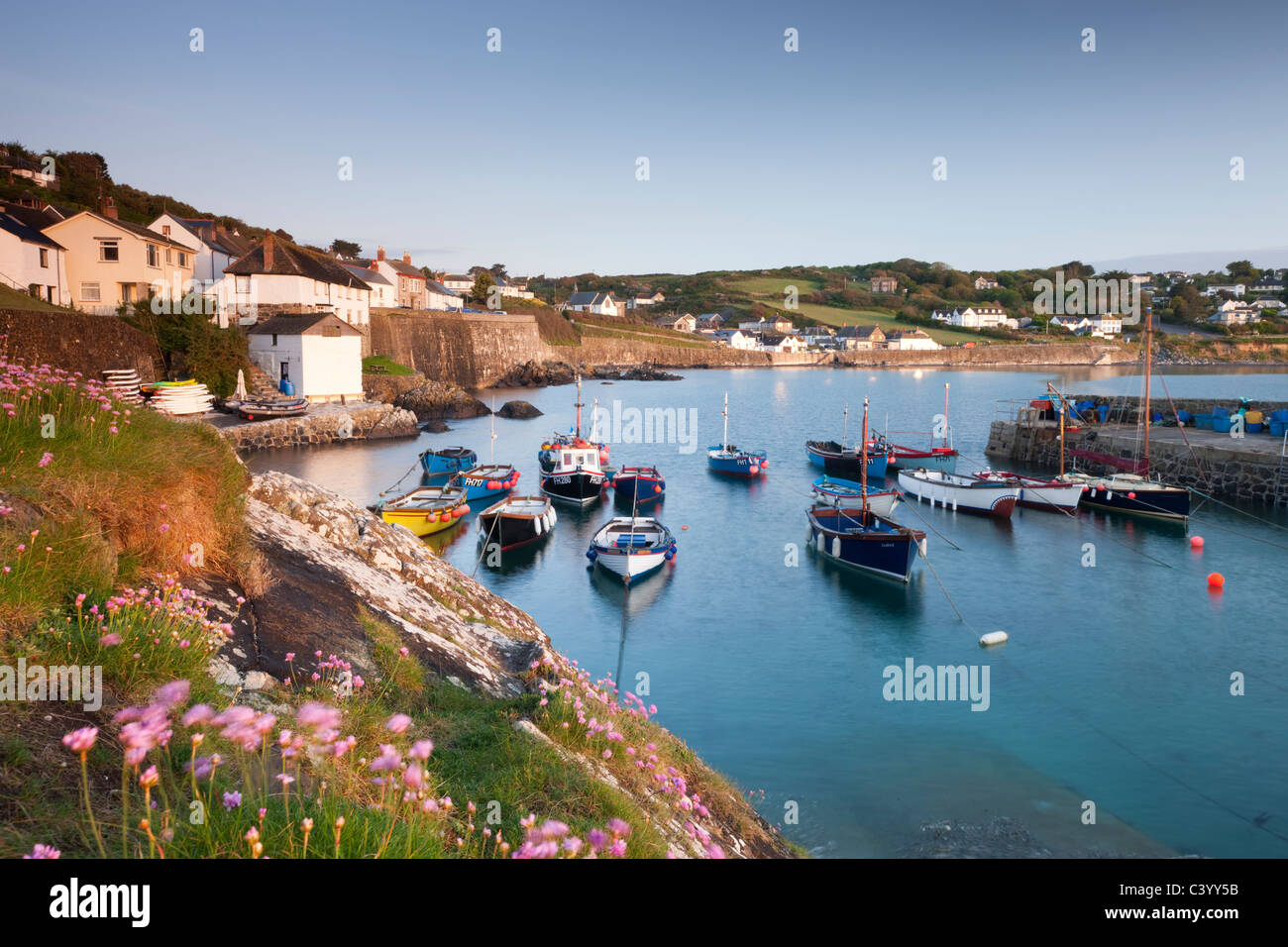 Pretty harbour and fishing boats at Coverack on the Lizard Peninsula, Cornwall, England. Spring (May) 2011. Stock Photo