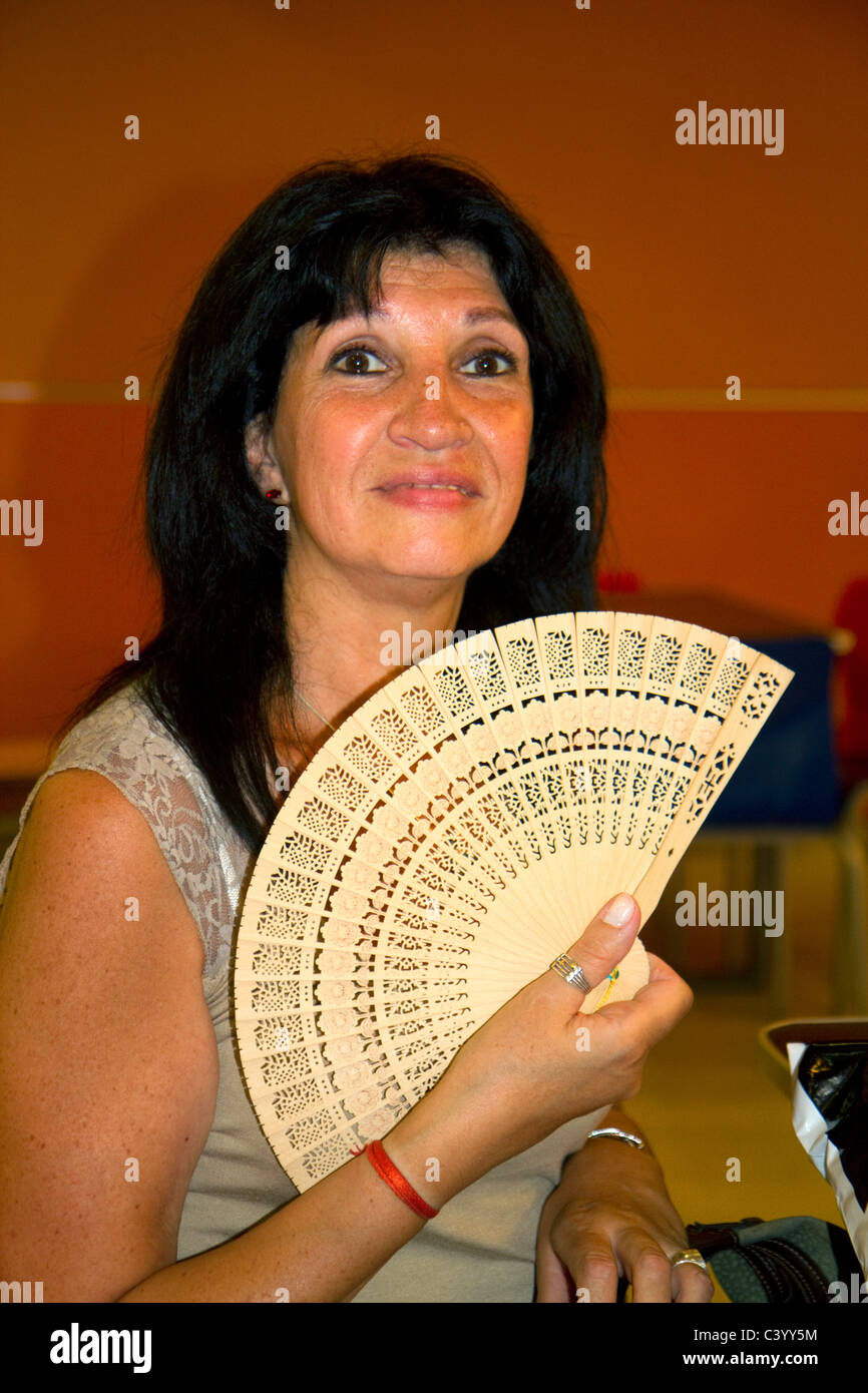 ab2e3642f1b96 Argentine woman holding a fan in Buenos Aires; Argentina. - Stock Image