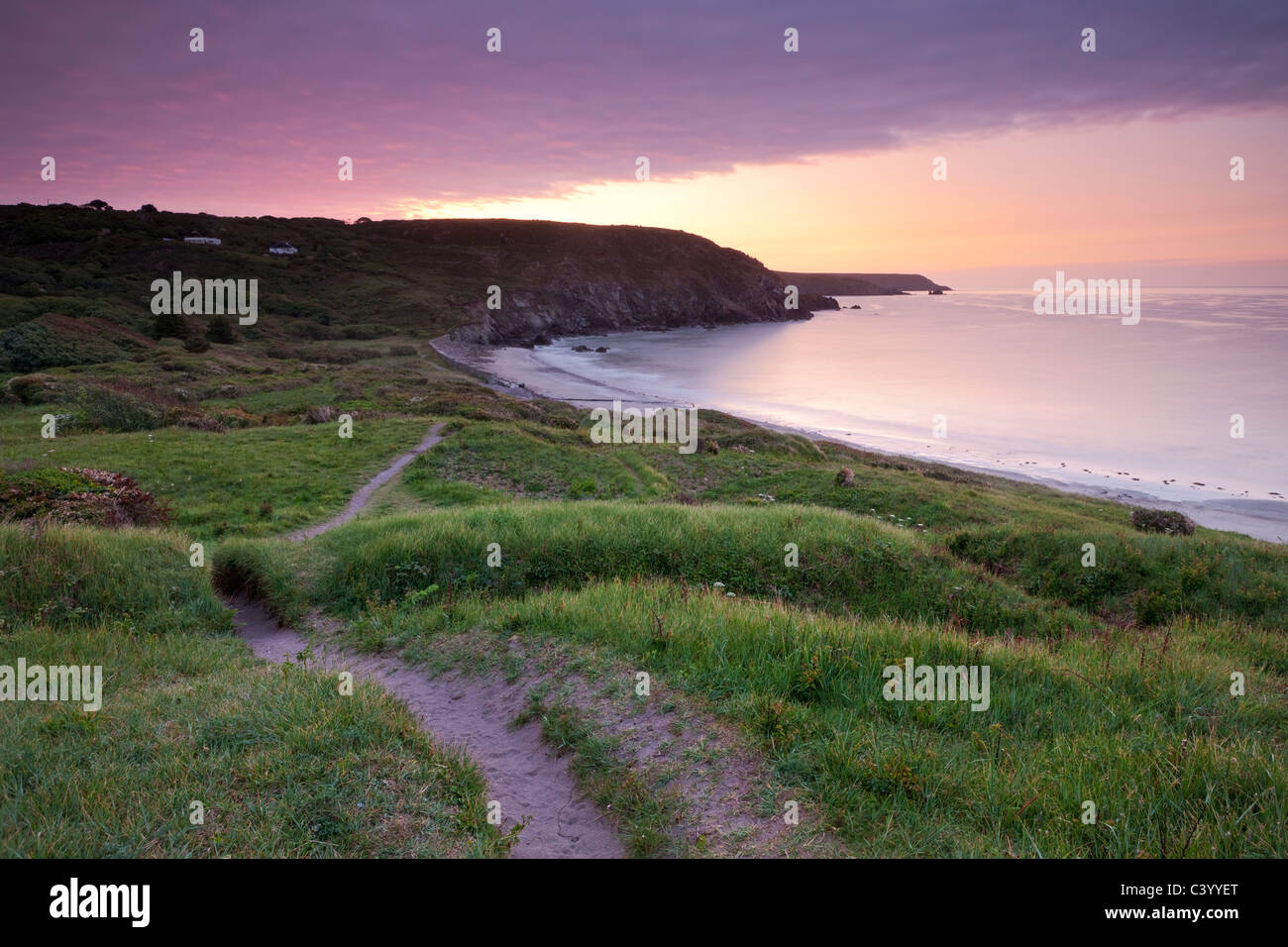 Sunrise on the South West Coast Path at Kennack Sands, Lizard Peninsula, Cornwall, England. Spring (May) 2011. - Stock Image