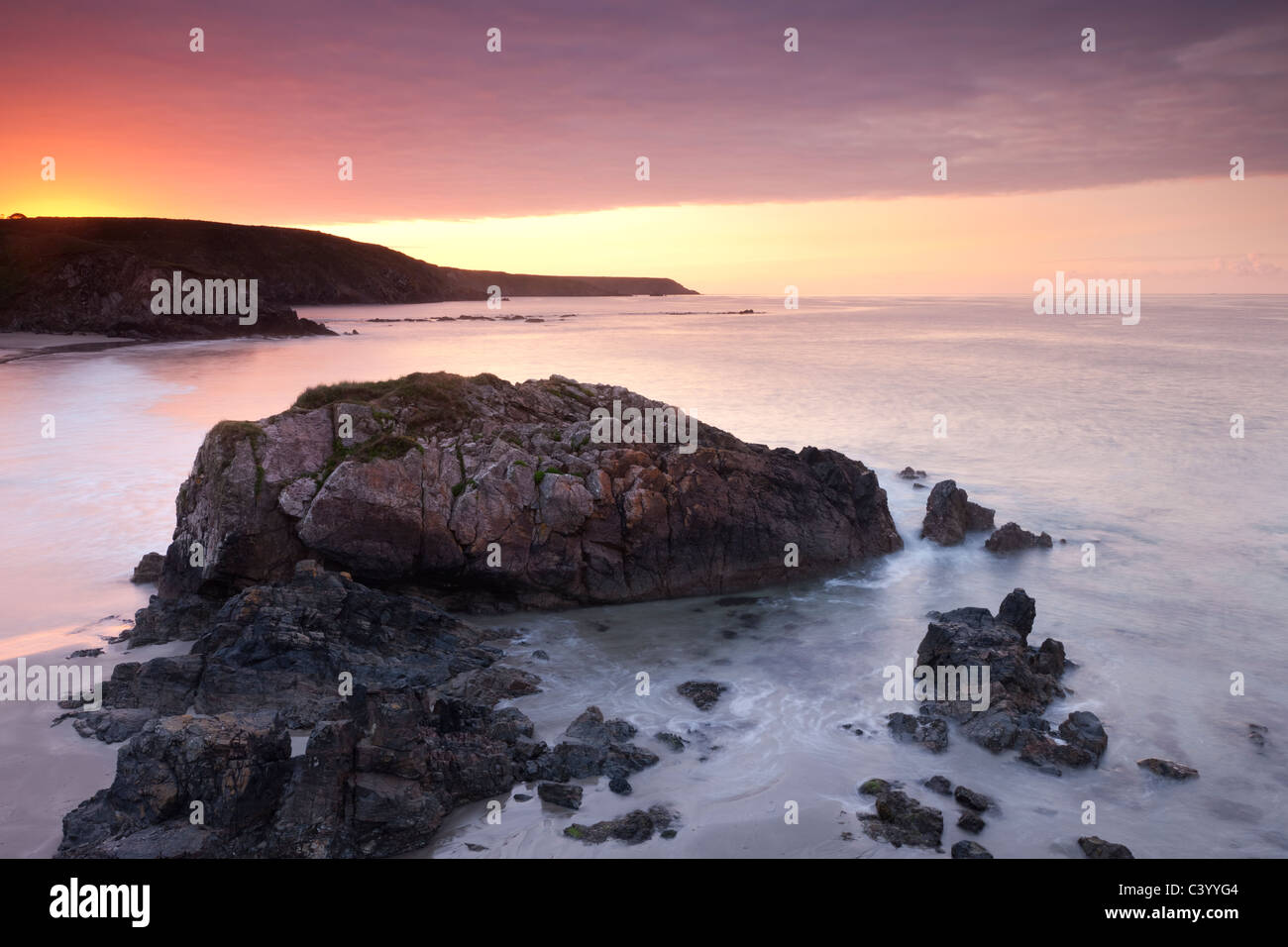Sunrise over Kennack Sands on the Lizard Peninsula, Cornwall, England. Spring (May) 2011. Stock Photo
