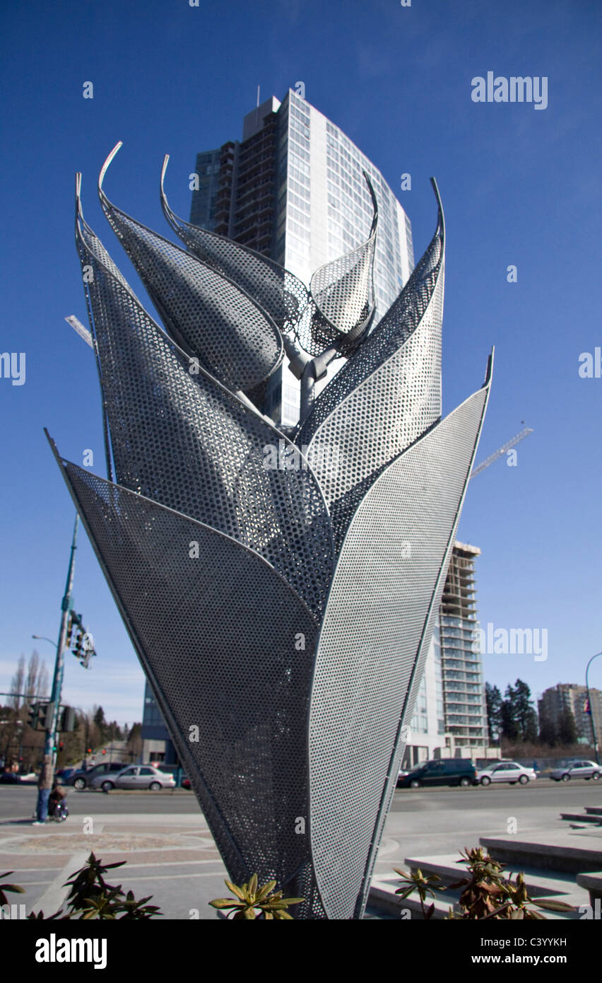 New Apartment building appears to grow out of metal sculpture, Holland Park, Surrey Central, BC, Canada - Stock Image