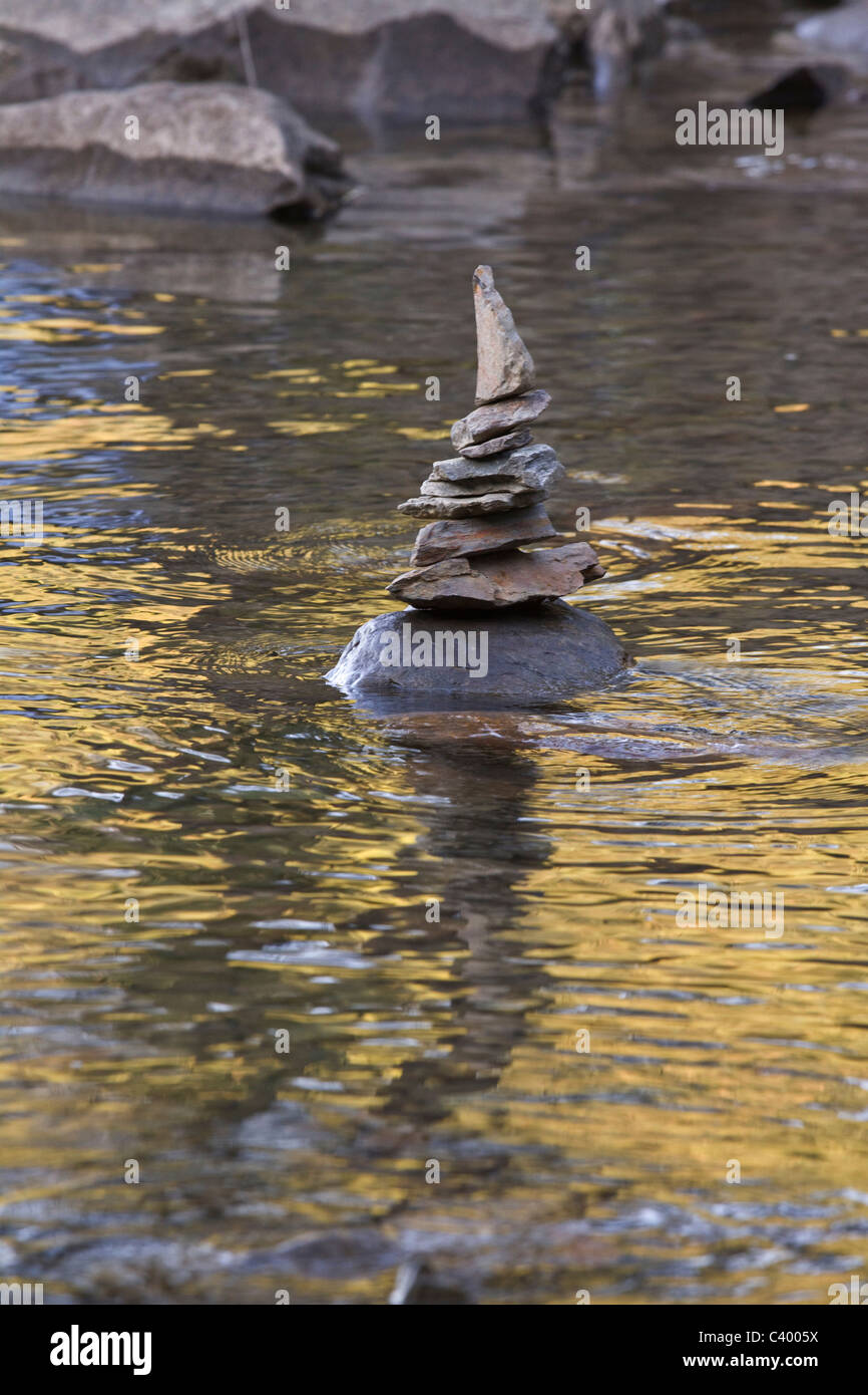 Creatively stacked stones reflected on Harrison Lake, near Harrison Hot Springs, BC - Stock Image