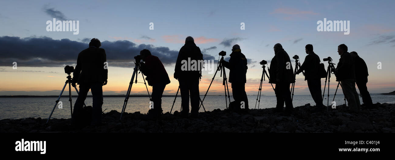 Photographers in silhouette - Stock Image