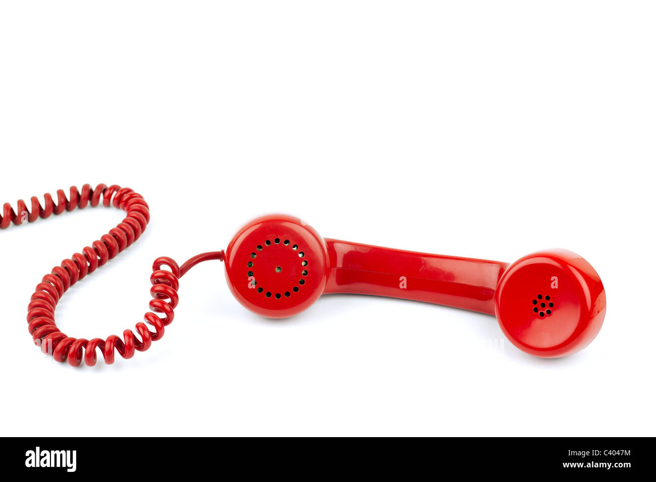 Telephone receiver and cord, isolated on white background - Stock Image