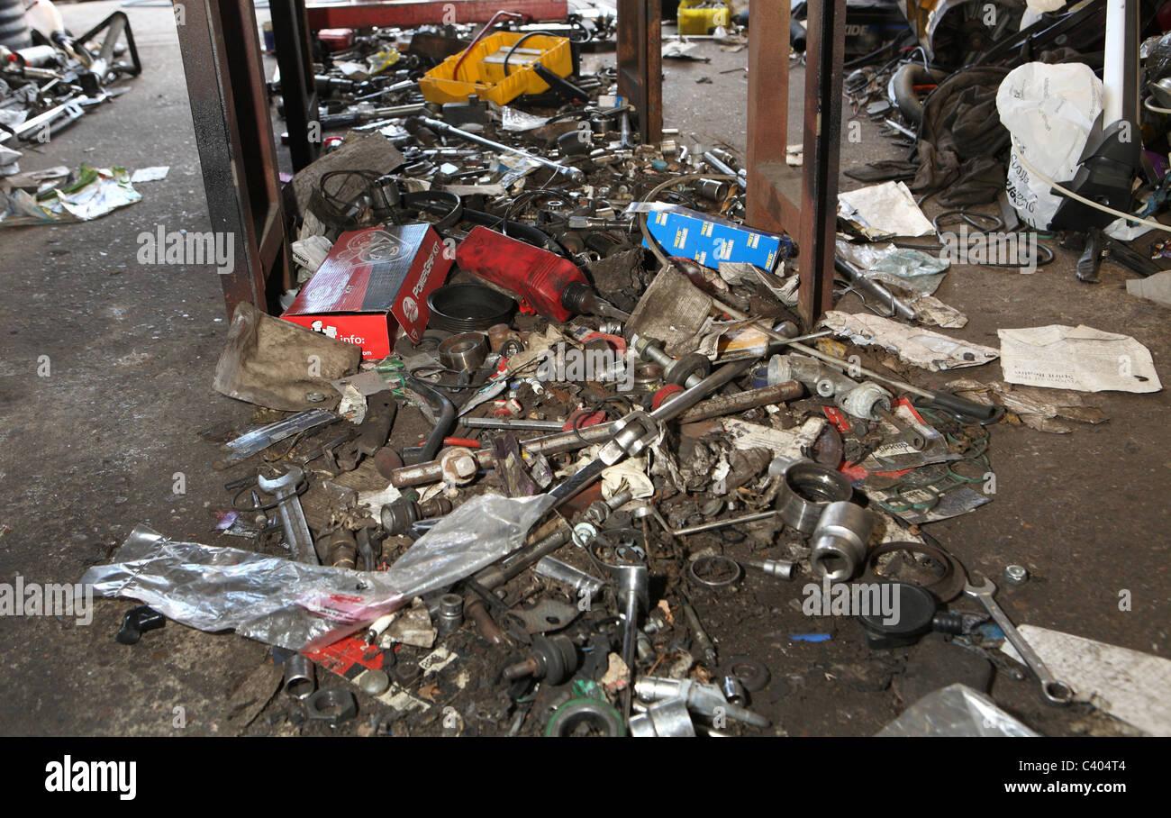 Dirty messy garage floor - Stock Image