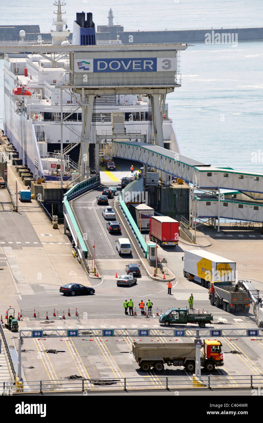 Cars and lorries embarking cross channel ferry at Dover Port - Stock Image