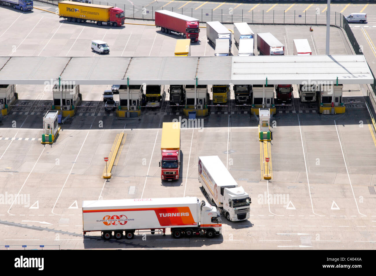 Lorries passing through check in booths before boading cross channel ferries Stock Photo