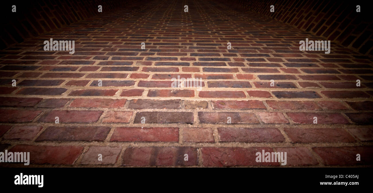 Low angle shot of brick wall. Interesting perspective textured background. - Stock Image