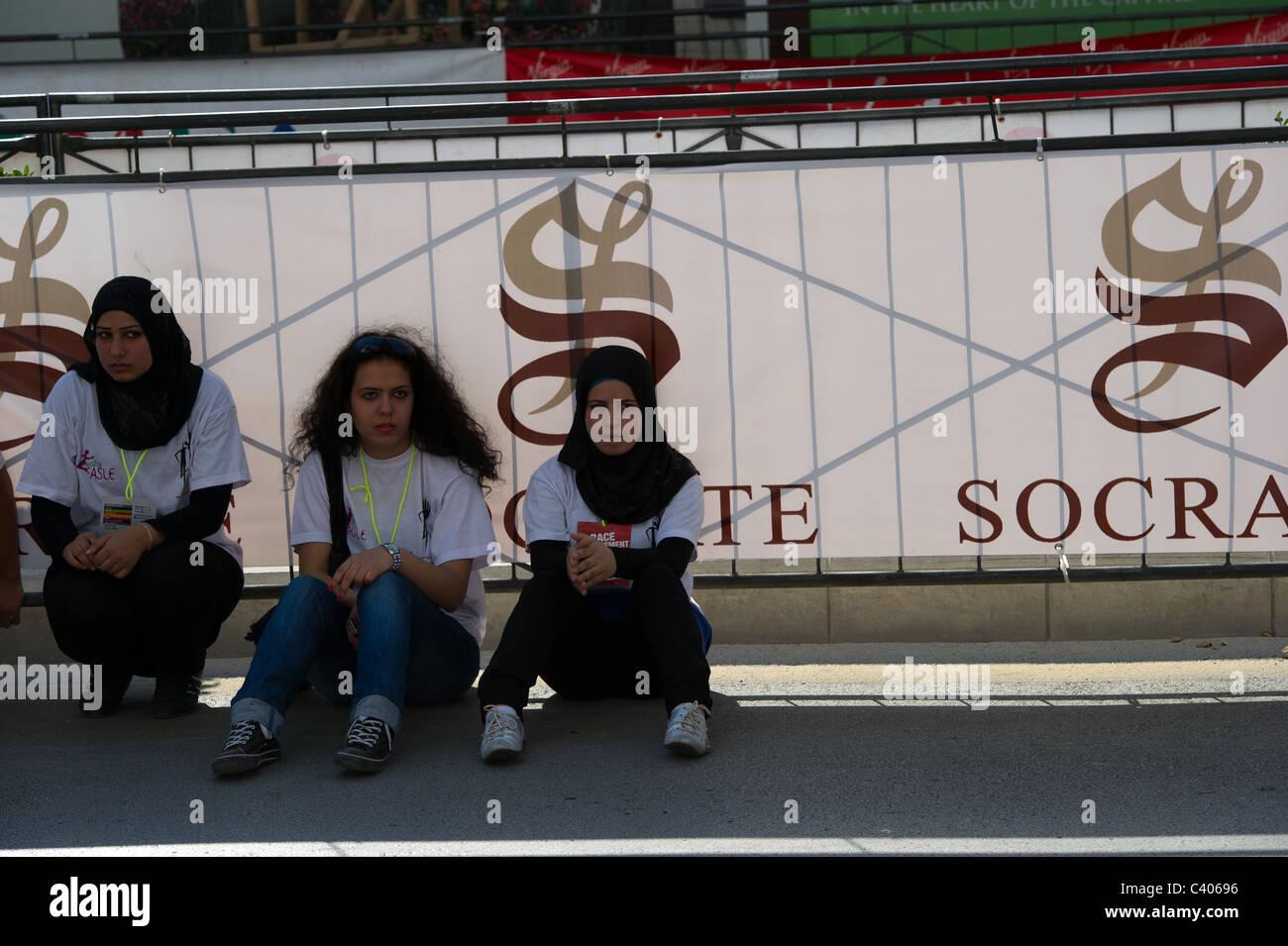 three young Muslim girls setting on the ground Stock Photo