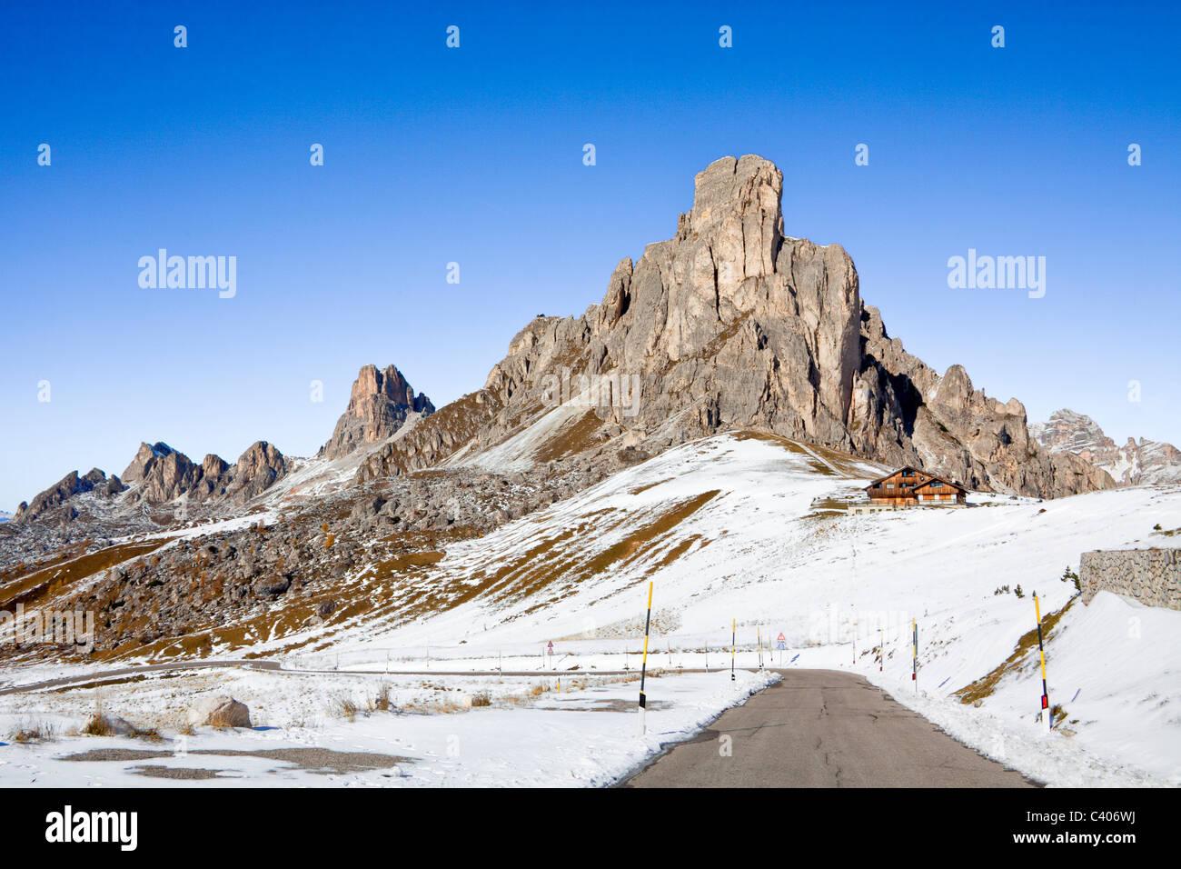 Italy, Europe, Dolomites, Alps, Giau, Pass, snow, mountains, street - Stock Image