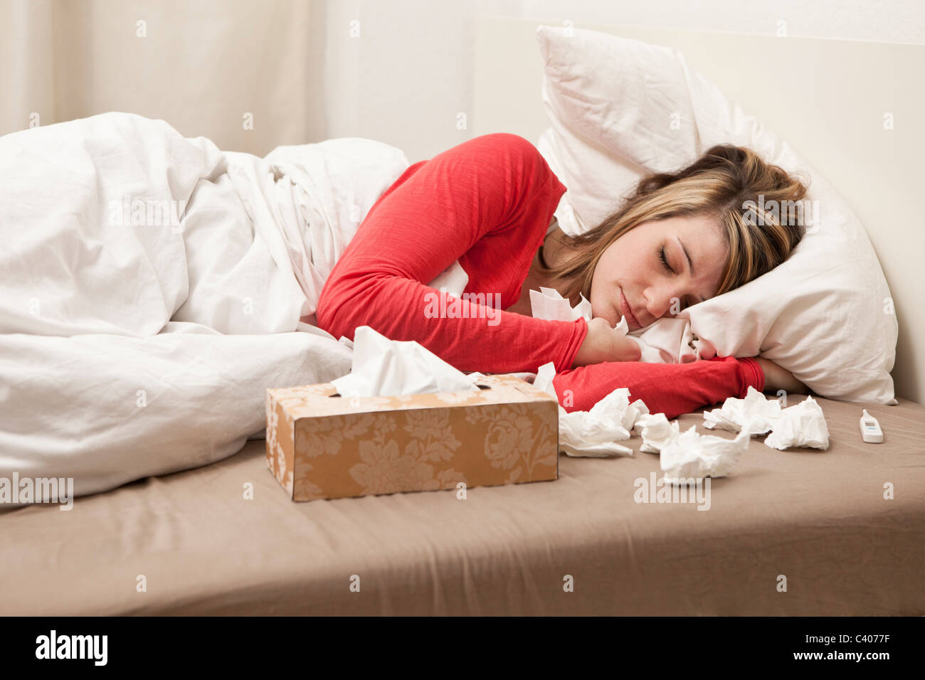 Woman with cold sleeping - Stock Image