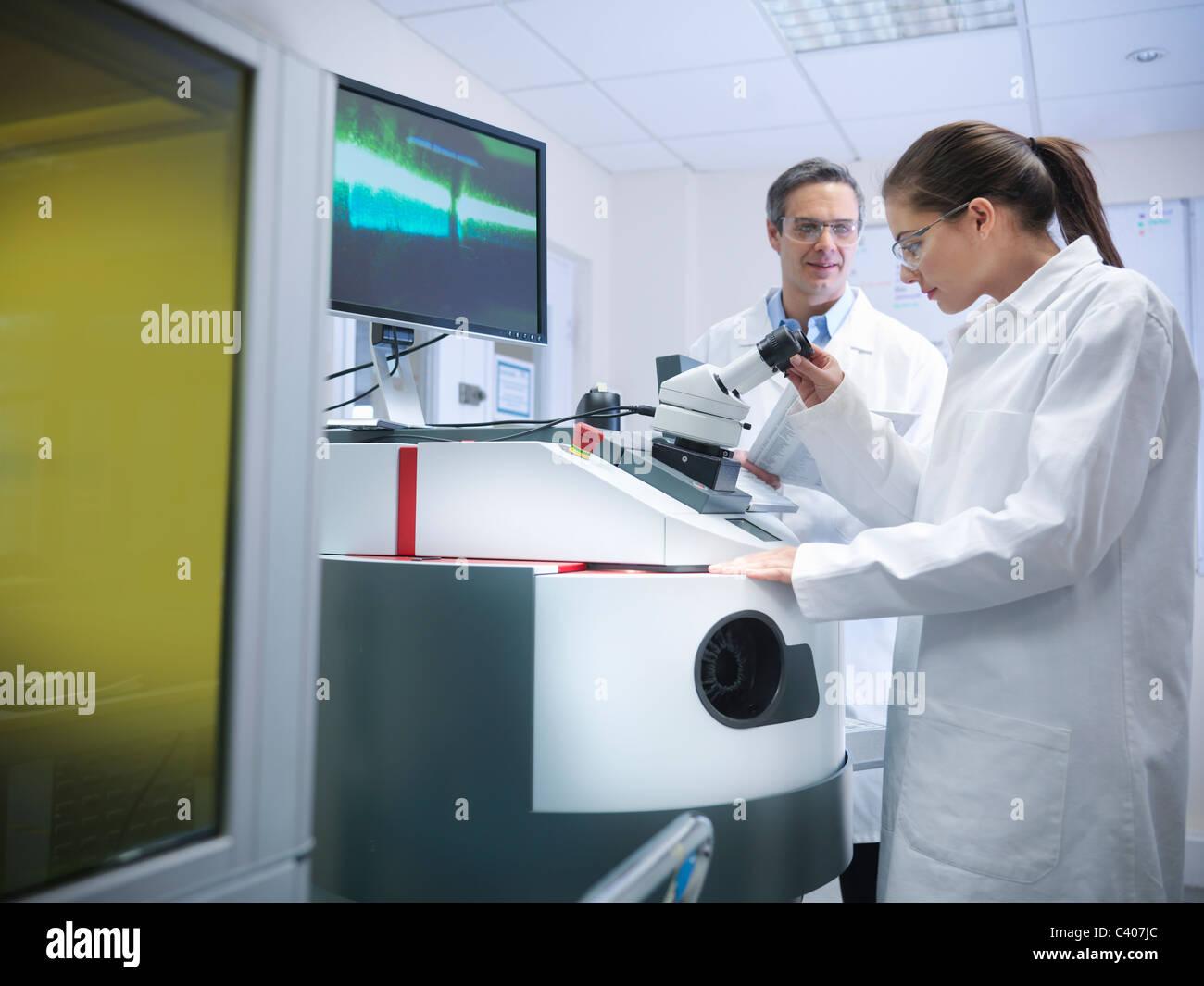 Scientists at laser welding machine - Stock Image