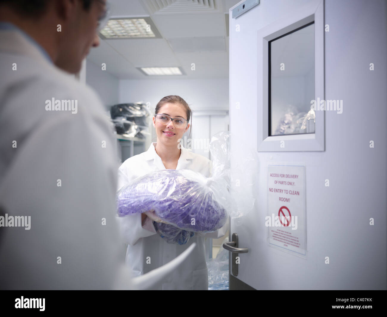 Scientist with product in laboratory - Stock Image