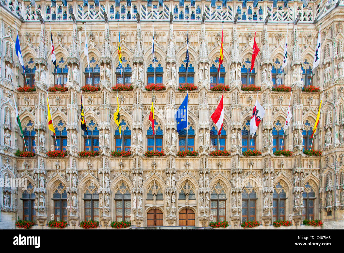 Belgium, Europe, Leuven, city hall, facade, Gothic, flags - Stock Image
