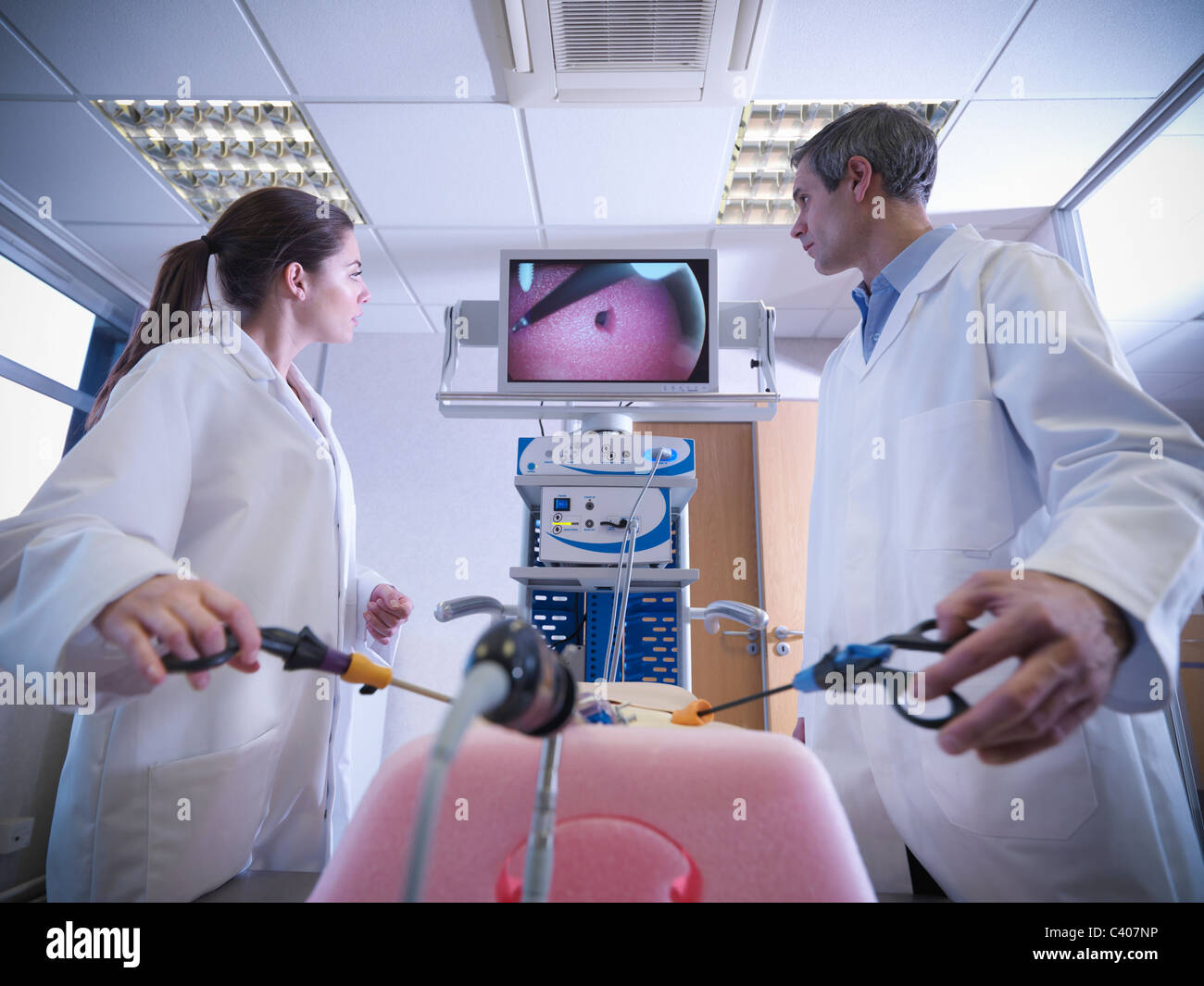 Scientists practice with simulator - Stock Image