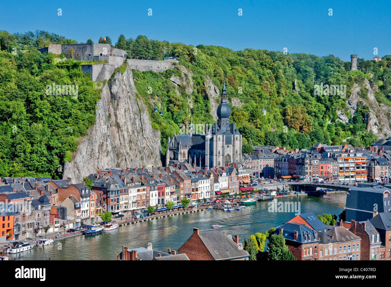 Belgium, Europe, Dinant, stronghold, castle, cliff, houses, homes, river, flow, boat, church - Stock Image