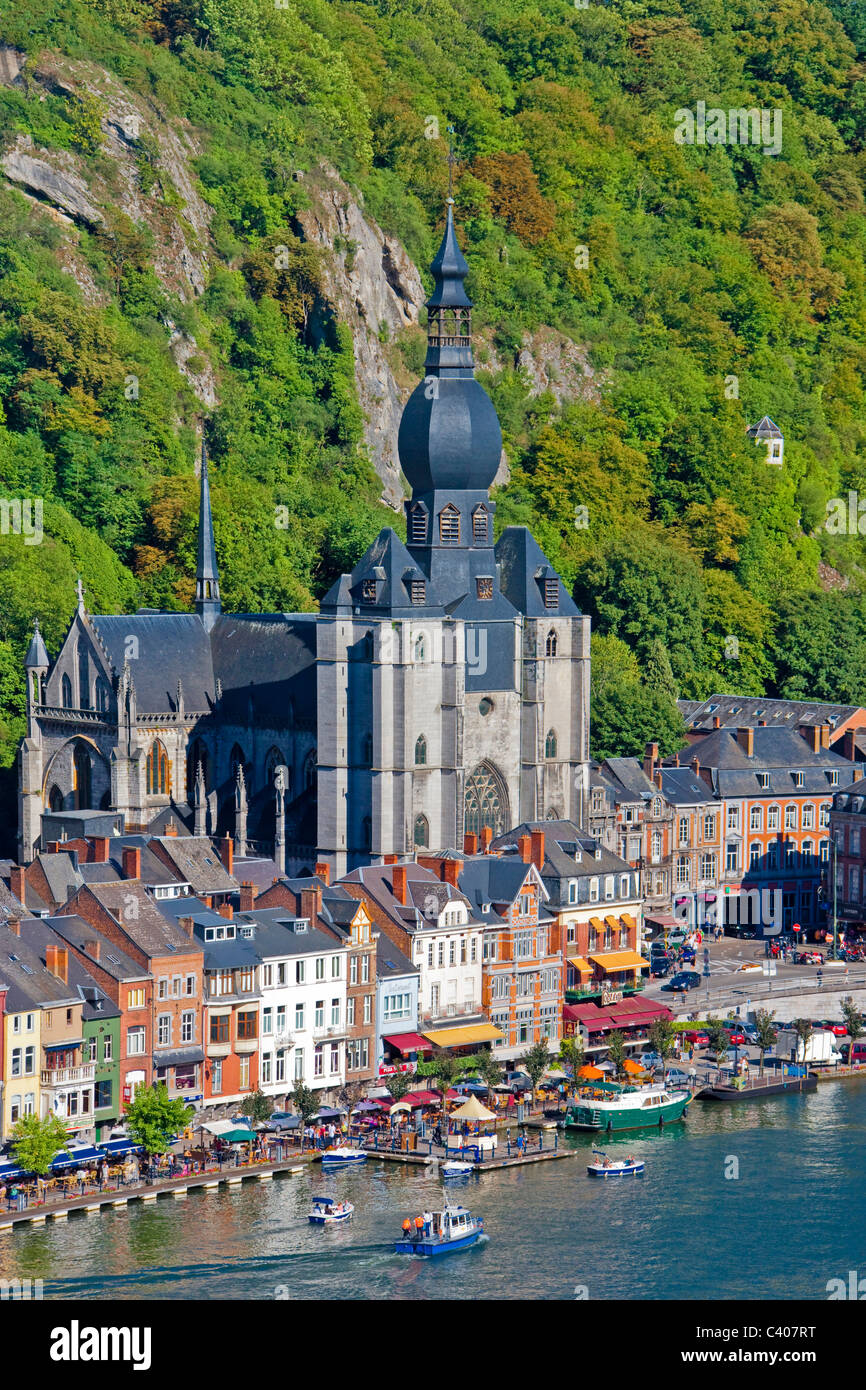 Belgium, Europe, Dinant, cliff, houses, homes, river, flow, boat, church - Stock Image