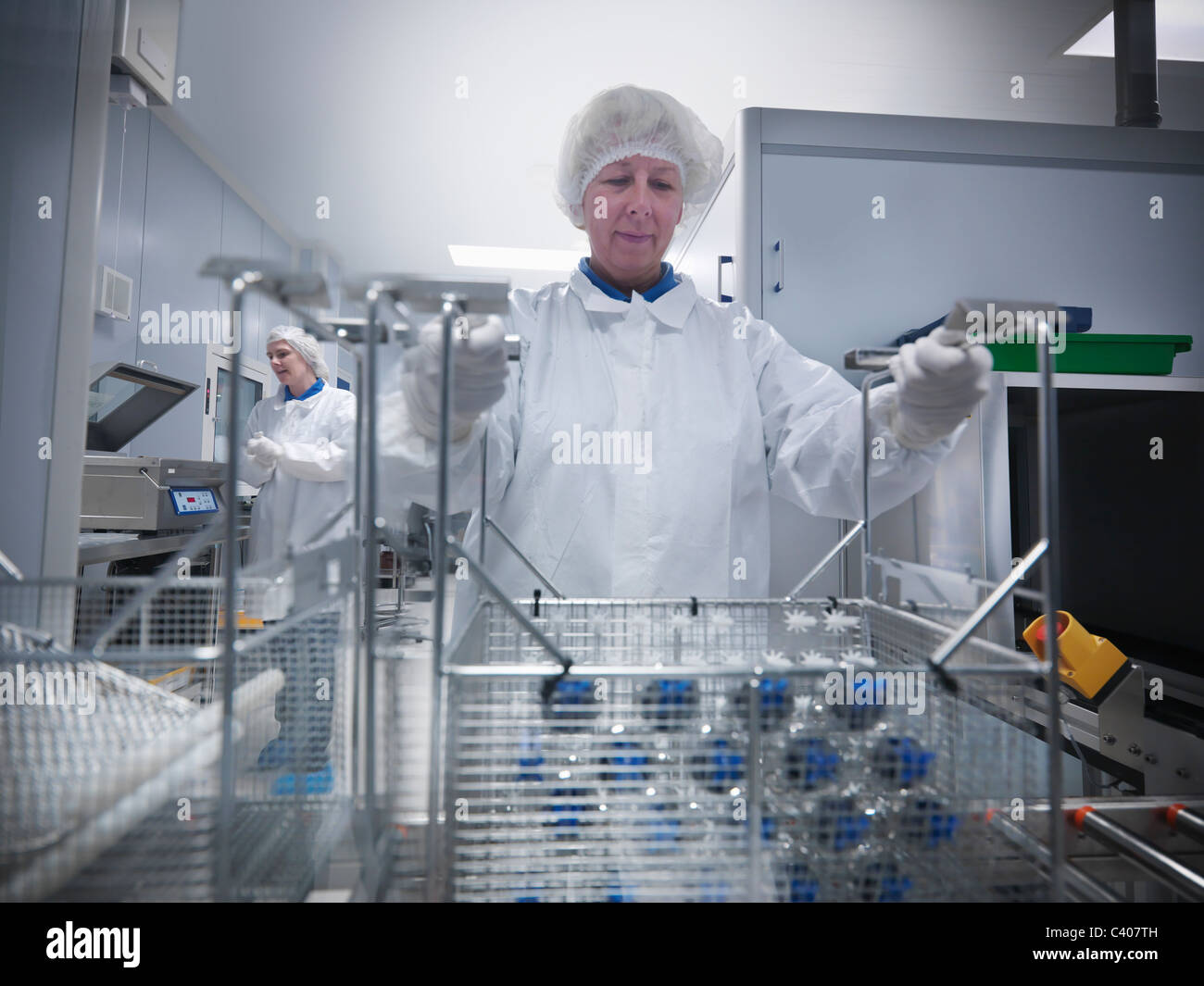 Scientists with product in clean room - Stock Image