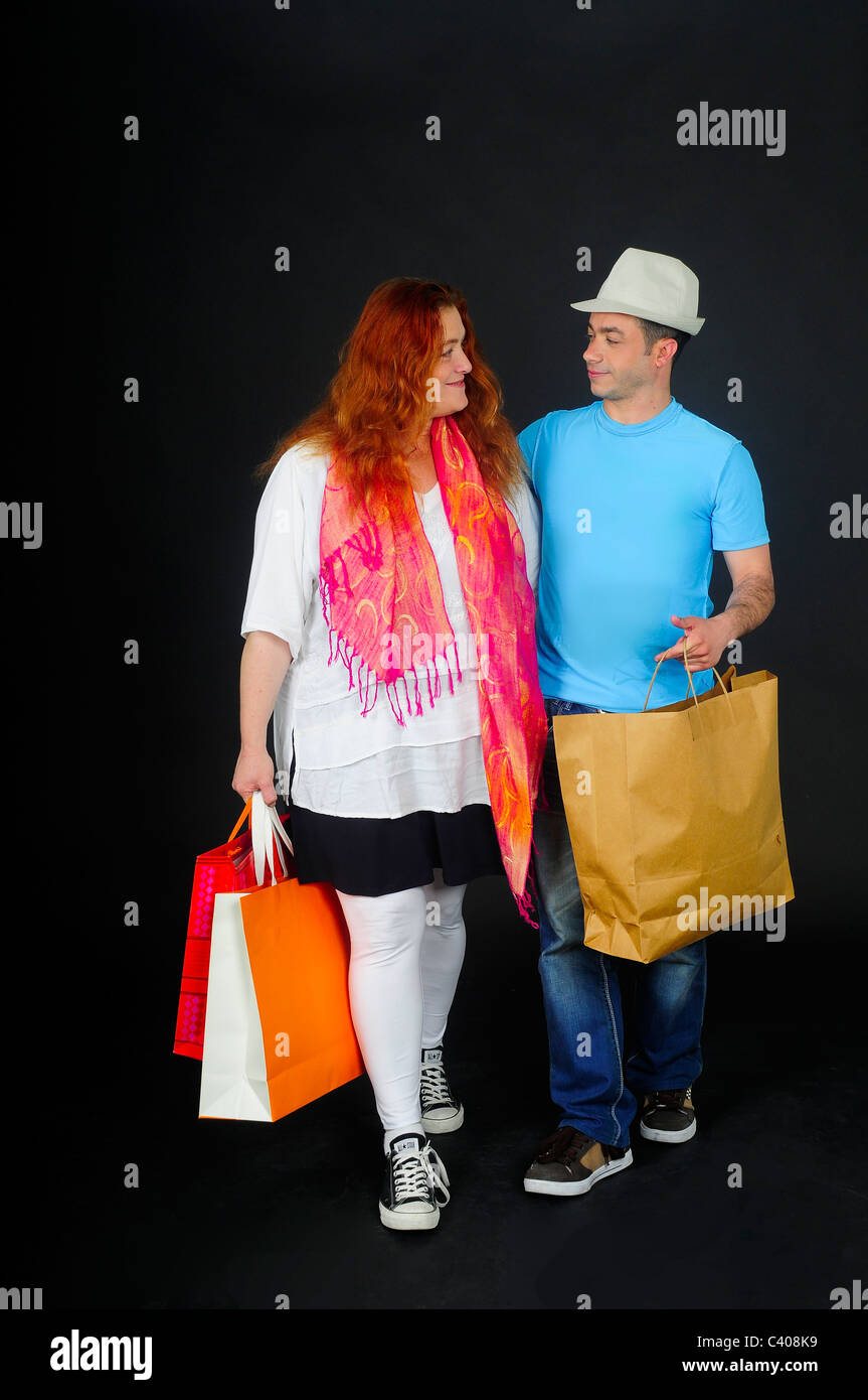 Comic Couple out shopping - Stock Image