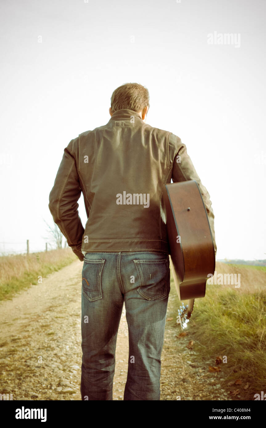 70th, view, go outside, picture style, outdoors, outside, one, individually, along, country lane, guitar, hair, - Stock Image