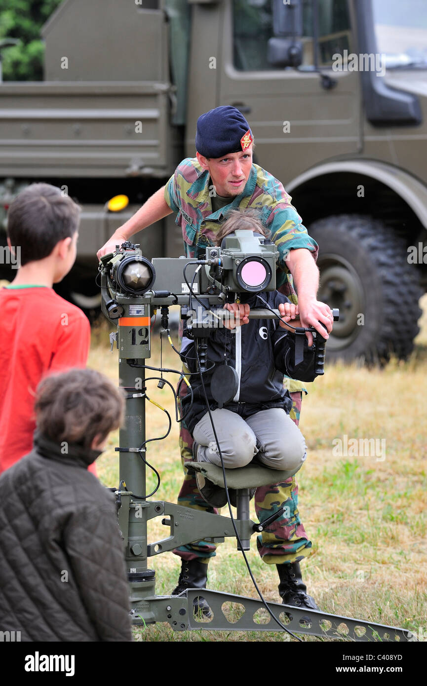 Soldier showing Mistral Air Defence Missile System to child during open day of the Belgian army at Leopoldsburg, - Stock Image