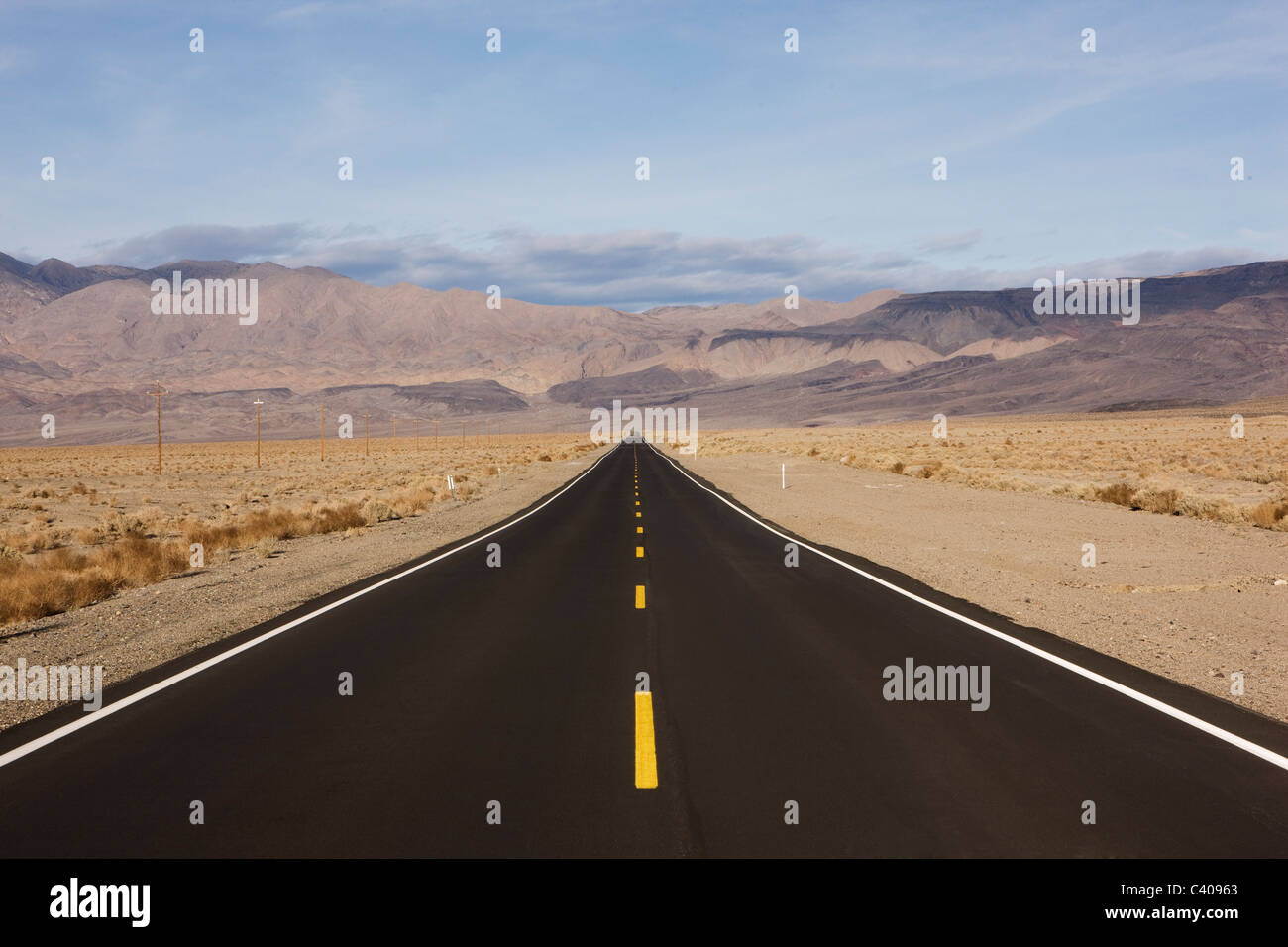 Dessert road with yellow stripes - Stock Image