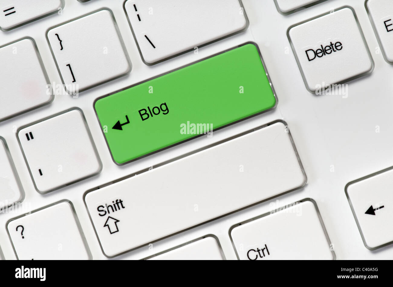 White keyboard buttons and green key blog - Stock Image
